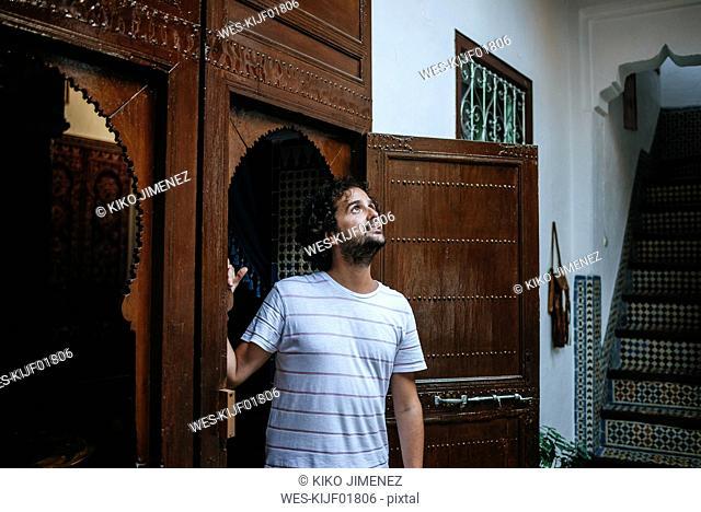 Morocco, Tanger, tourist admiring traditionally Moroccan interior architecture
