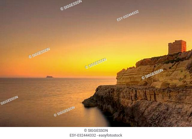 A beautiful sunset over the island of Filfla just outside Malta in the Mediterranean Sea