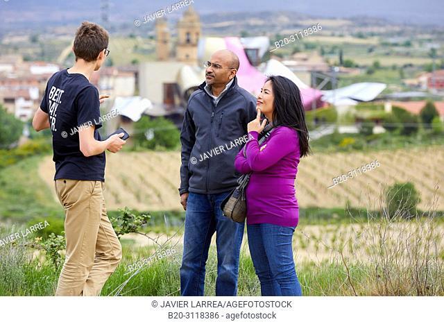 Guide with couple of tourists, Vineyard, Bodegas Marques de Riscal, Elciego, Rioja Alavesa, Araba, Basque Country, Spain, Europe