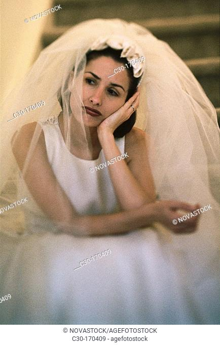 Thoughtful bride waiting for groom