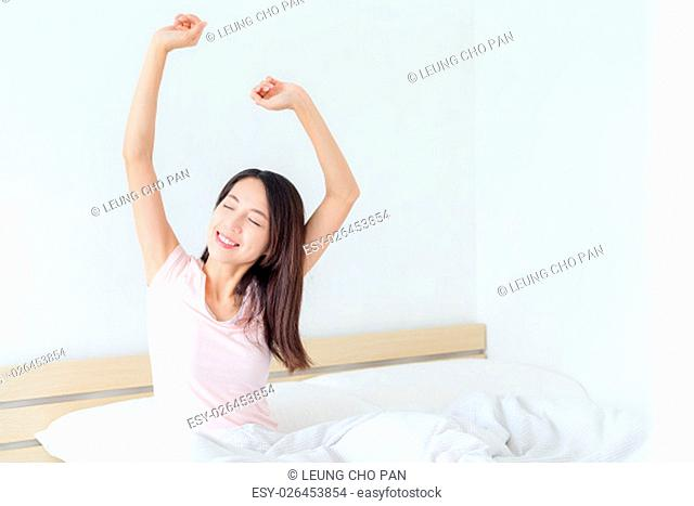 Woman waking up at morning