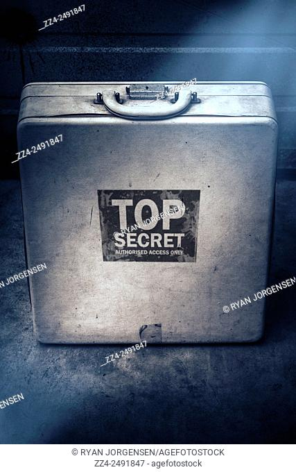 Vintage still life photo of an information packed top secret briefcase hiding classified secrets. Deceit in secret surveillance