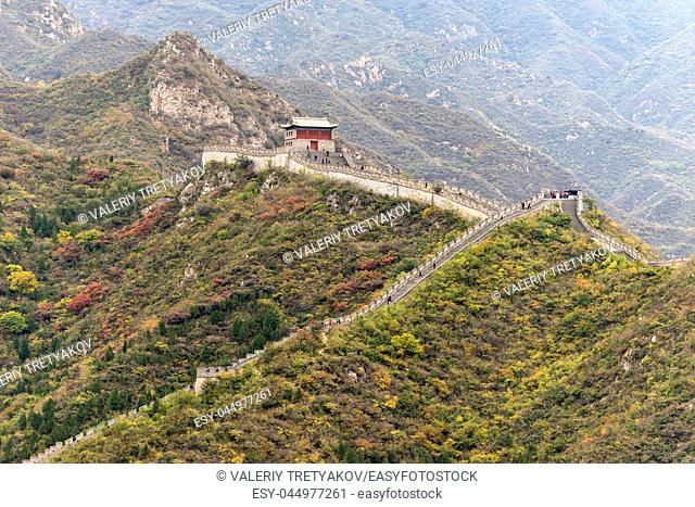 "A lot of tourists (unrecognizable) visit the Great Wall of China and admiring the architectural """"miracle"""""