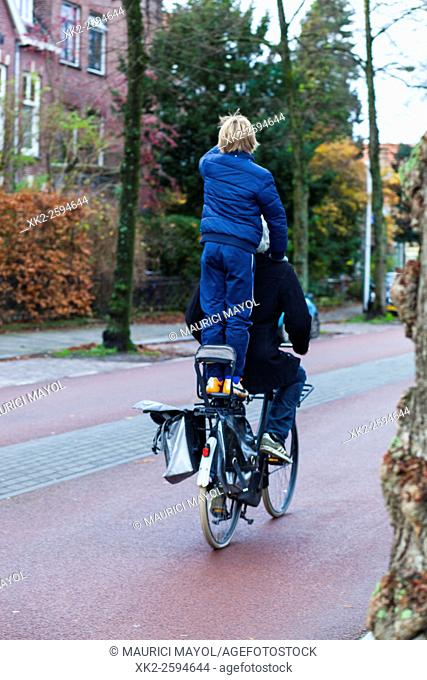 Father and son riding on a bike, Utrecht, The Netherlands