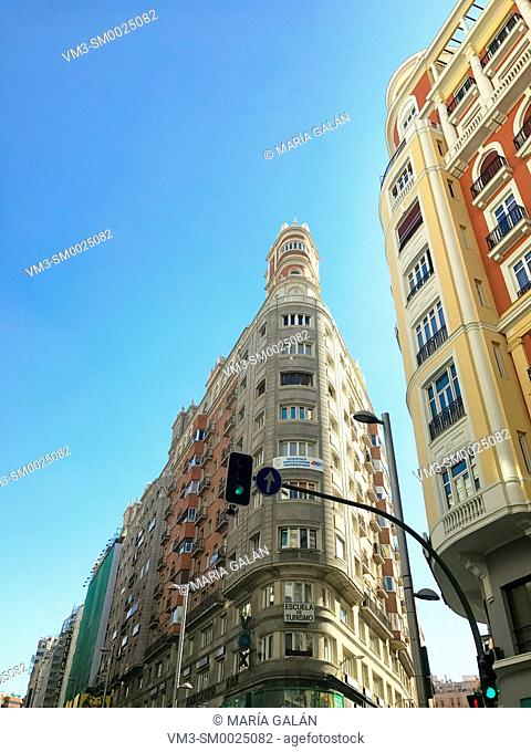 Facades of buildings. Gran Via street, Madrid, Spain