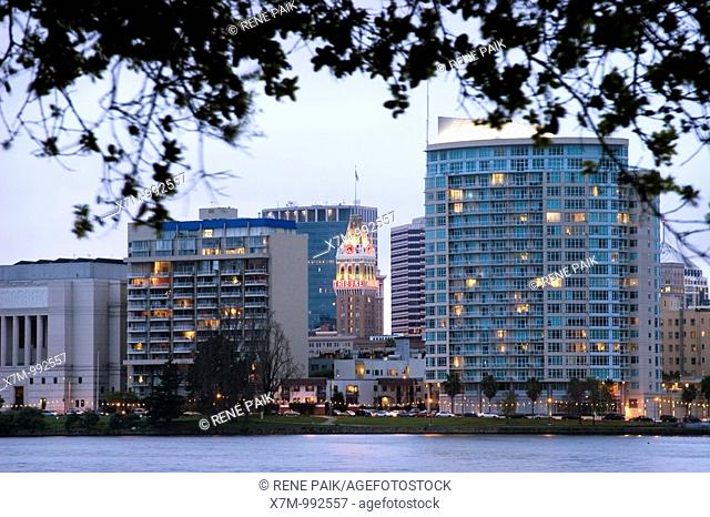 View of the landmark Oakland Tribune building from across Lake Merritt on a stormy day  Lake Merritt is refered to as the Jewel of Oakland  It's the largest...