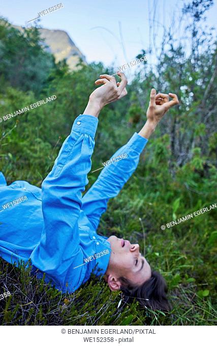 young teenage man enjoying nature