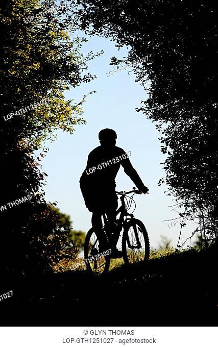 England, Buckinghamshire, Weston Underwood, Silhouette of a man riding a mountain bike