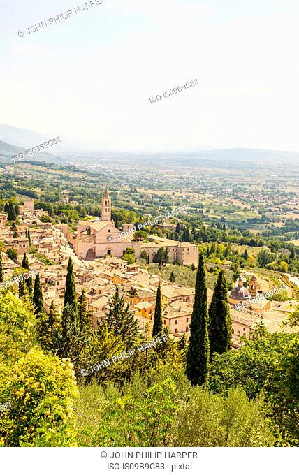 Landscape view of rooftops and Basilica of Saint Francis of Assisi, Assisi, Umbria, Italy