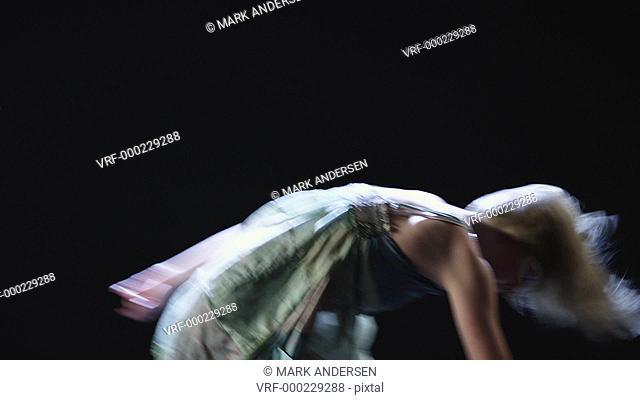 MS Studio shot of young woman dancing