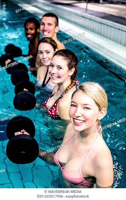 Fit people doing an aqua aerobics class