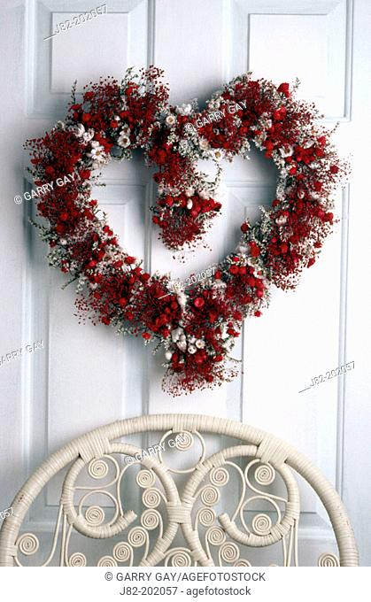Flower heart wreath on door