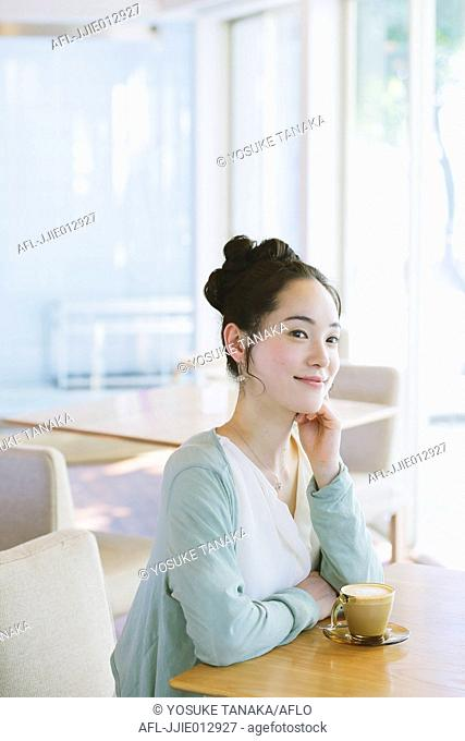 Japanese woman relaxing in a cafe