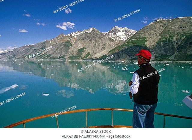 Tourist boating Tarr Inlet Glacier Bay Natl Park SE AK summer scenic
