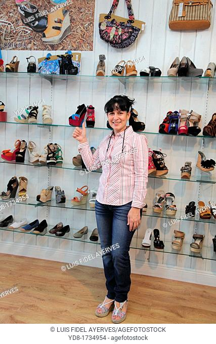 Store clerk happy handbags and shoes that had a good day, Miami Beach, Florida, USA