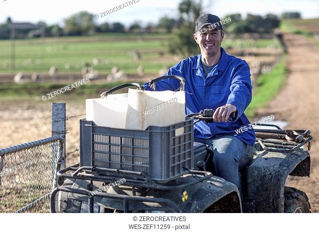 Smiling farmer on a quadbike