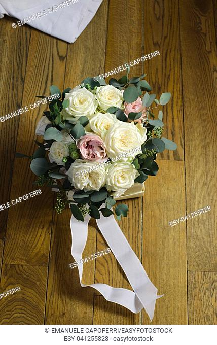 wedding bouquet of flowers with white roses and pink peonies