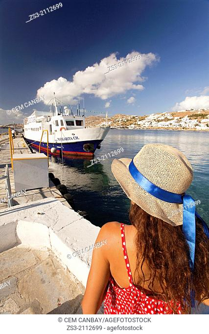 Woman with straw hat at the old harbour, Mykonos, Cyclades Islands, Greek Islands, Greece, Europe