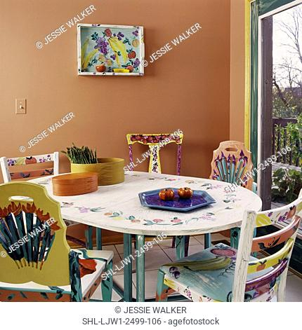 Kitchen with painted breakfast table and chairs, whimsical fun painted chairs and table, colorful and fun