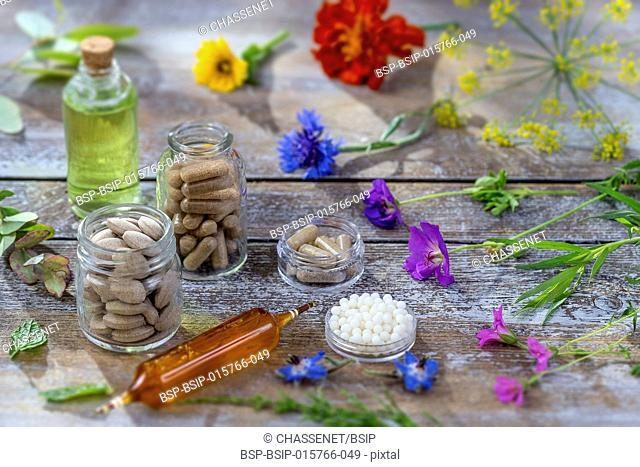 Alternative herb medicine. herbal vitamin on wooden board
