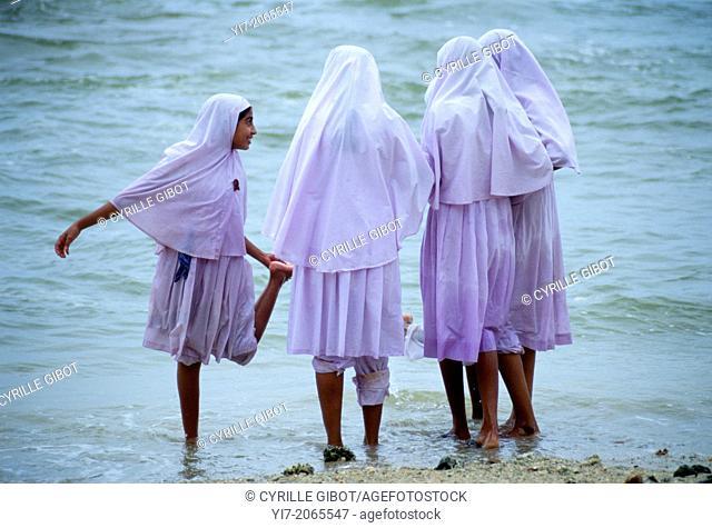 Young veiled Muslim women on the beach, Galle, Sri Lanka
