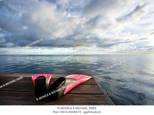 Hawaii, Pink fins on dock at sunset