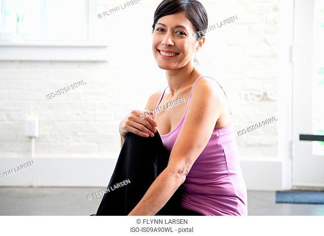 Mature woman in pink vest smiling, portrait