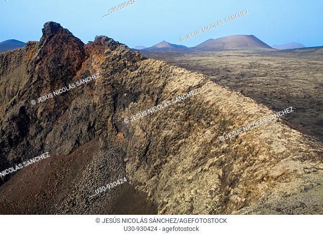 Crater rim of Raven Volcano  Volcan del Cuervo  The bottom Ortiz and Caldera Colorada volcanoes  Mancha Blanca  Tinajo  Lanzarote  Las Palmas province  Canary...