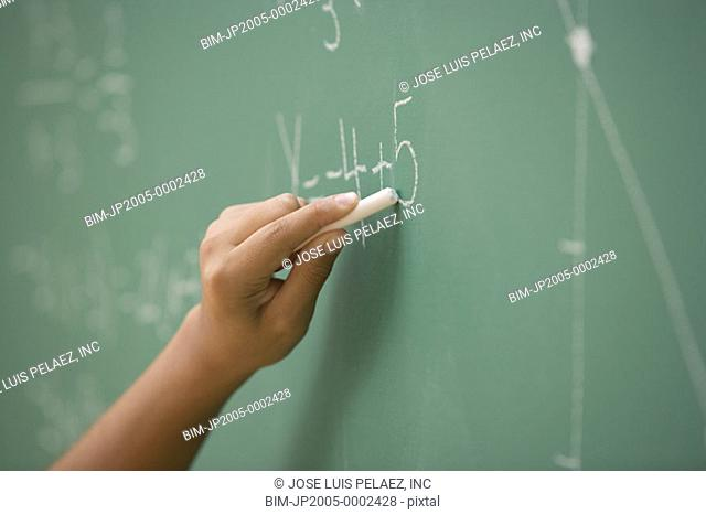 Student doing mathematics on the chalkboard
