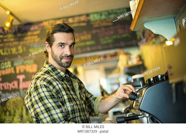 A coffee shop and cafe in High Falls called The Last Bite. A man making coffee