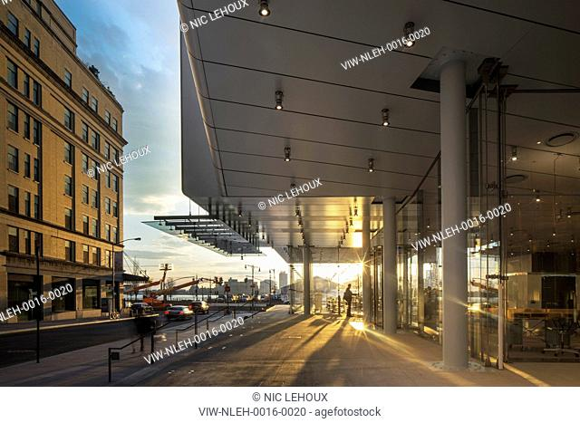 Canopied entrance area at dusk. Whitney Museum of American Art, New York, United States. Architect: Renzo Piano Building Workshop, 2015