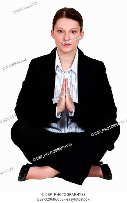 preppy woman in lotus position
