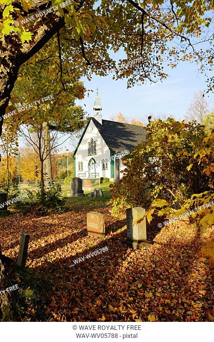 View of Holy Trinity Church Iron Hill Anglican in autumn landscape, Eastern Townships, Quebec, Canada