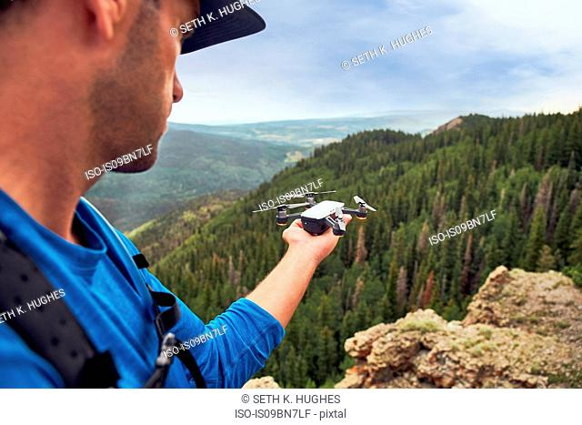 Hiker on mountain peak, Mount Sneffels, Ouray, Colorado, USA