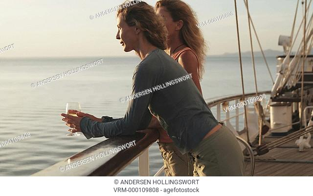 two women on a yacht having a glass of wine