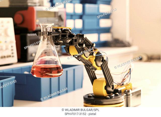 Robotic arm holding chemical flask