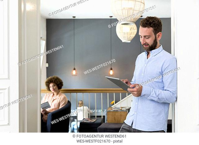 Young man using digital tablet in a cafe
