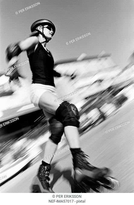 A young woman on rollerblades France
