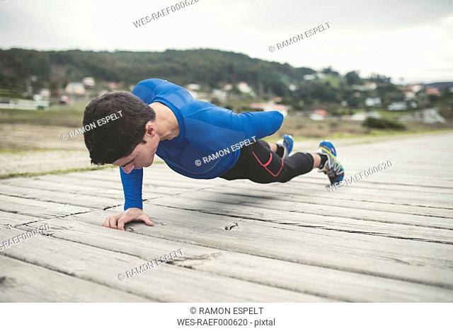 Runner doing strength training outdoors
