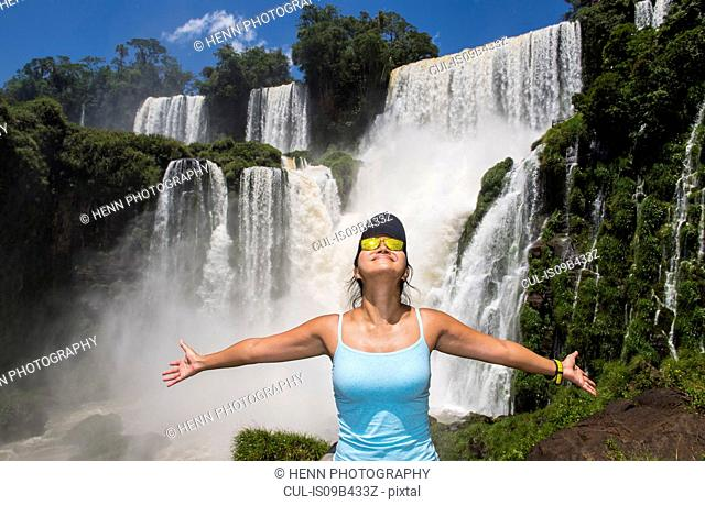 Woman posing in front of Iguazu falls, Misiones, Argentina