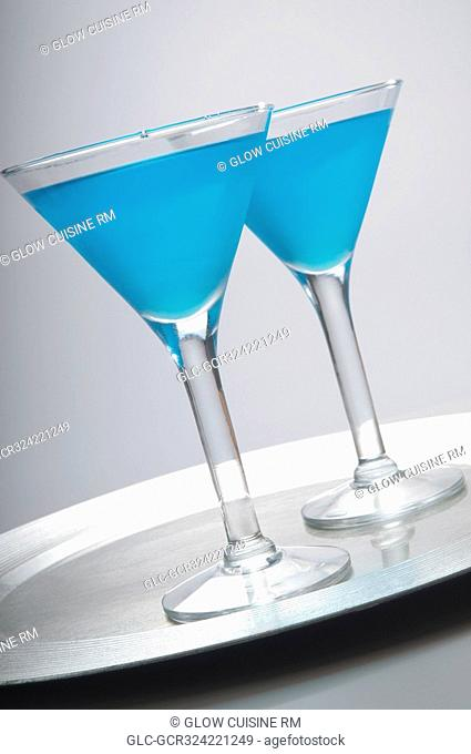 Close-up of two glasses of blue cocktail