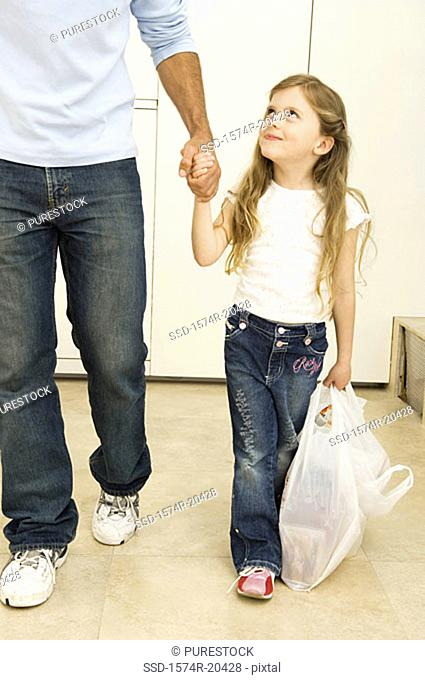 Girl walking with her father