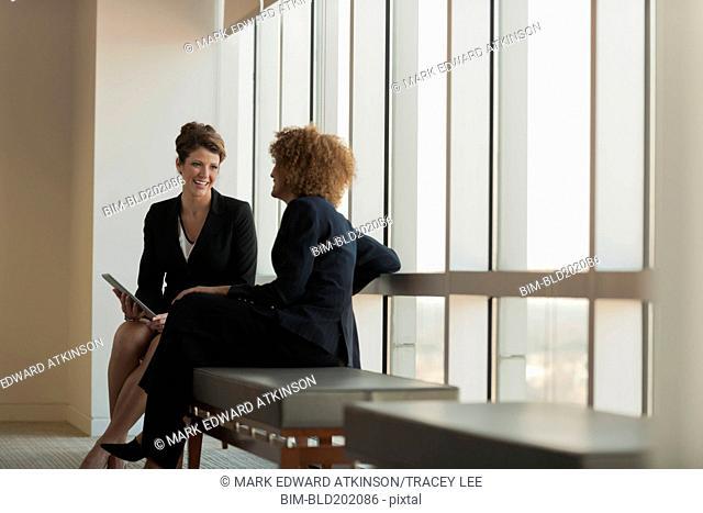 Businesswomen talking in waiting area