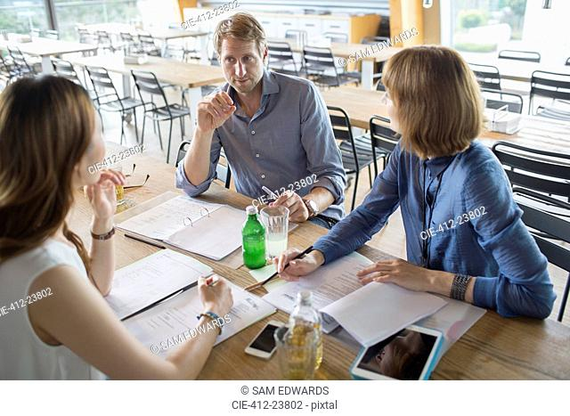 Business people talking in meeting in cafeteria