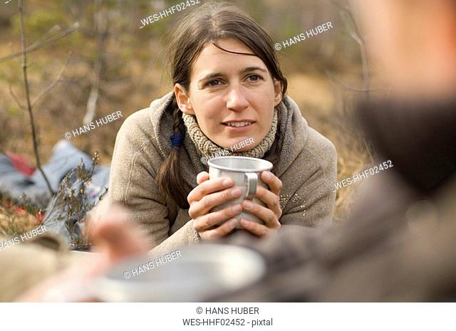 Austria, Salzburg County, Young woman holding a cup