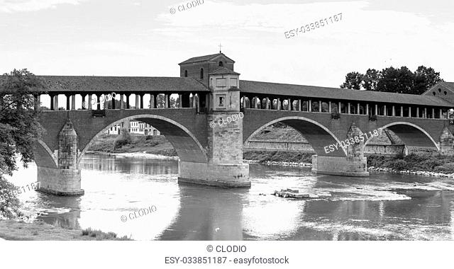 Pavia (Lombardy, Italy): the famous covered bridge over the Ticino river. Black and white