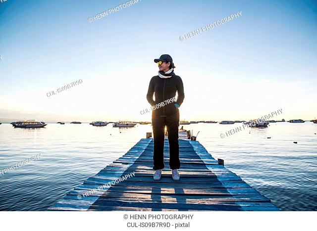 Woman standing on pier at Lake Titicaca, Copacabana, Bolivia