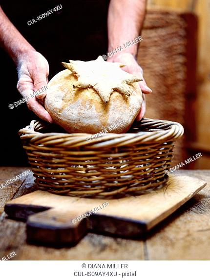 Home-made bread being placed into a basket