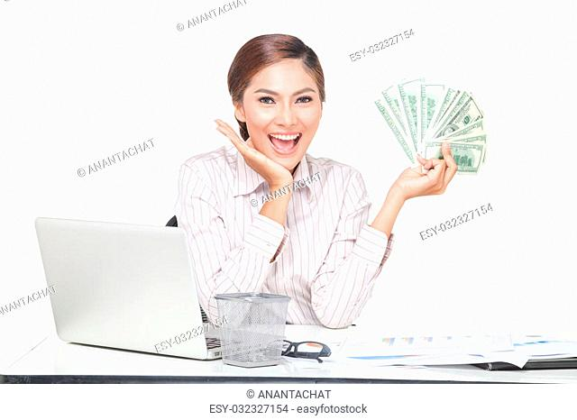 Asian business woman hold some of bank notes in hand and point with the another hand ,smiling face. isolated on white