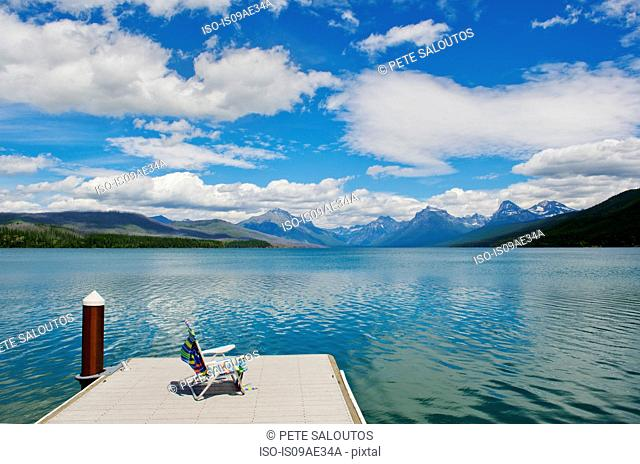 Deckchair on jetty, lake McDonald, Glacier National Park, Montana, USA